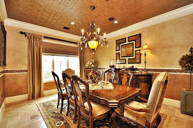Tuscan Style Tin Ceiling In Dining Room With Green Walls