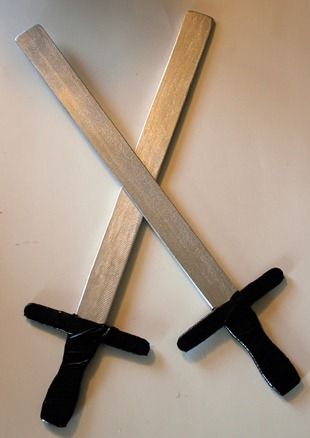 Pirate swords made with paint sticks, craft sticks, a little paint and duct tape