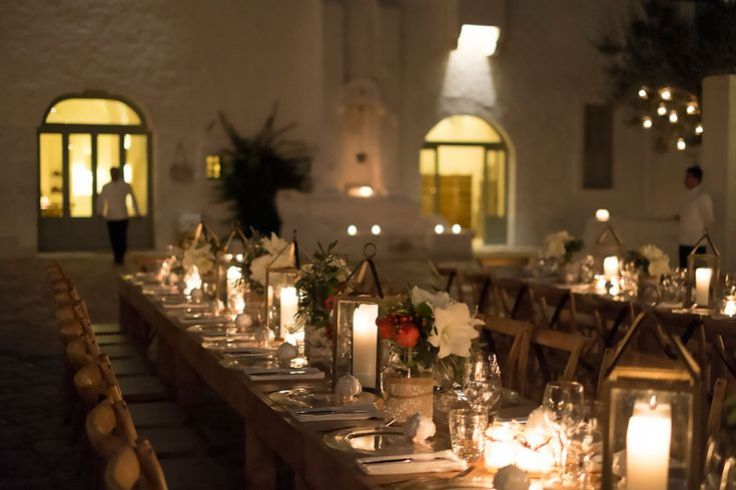 Long dining tables with candle lanterns at Masseria Le Carrube in Puglia, Italy
