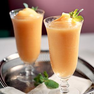 Mix frozen peach slices, ice, sugar, vodka, and peach schnapps in a blender until smooth – a fan fav
