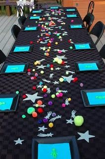 Love the colors and the pom pom planets with the glow in the dark stars…aliens on the plates are cute too.