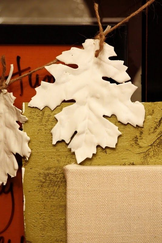 these stylish leaves are fabric ones from the dollar store… dipped into plaster of paris. FABulous idea for garlands, wreaths,