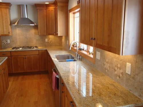 Kashmir White granite maple cabinets | Help me pick a ... on Natural Maple Cabinets With Black Granite Countertops  id=77718