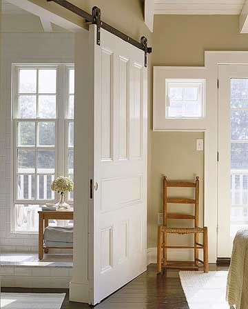 Sliding Barn Door This Isn T Just A It Also Functions As Wall White Paneled Does Double Duty In Master Bedroom