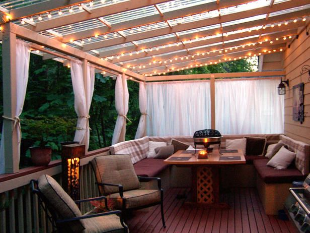 Some ideas here for the back patio and cover. I like the strings of lights, curtains on curtain rod, got to have a nice outdoor