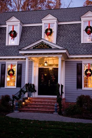 Classic xmas  this is our look for 20 years, wreath hanging on the red ribbon with a red bow and a lighted candle inside the