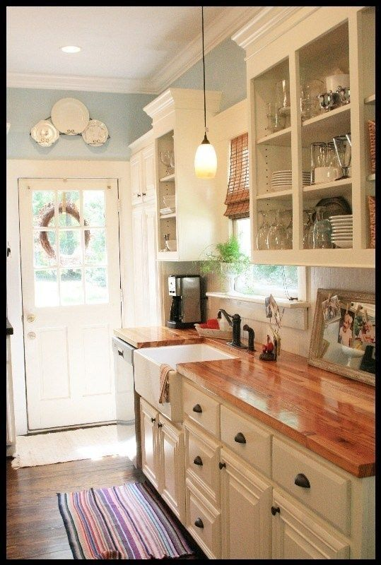 white cabinets butcher block countertops and pretty blue on good wall colors for kitchens id=79849