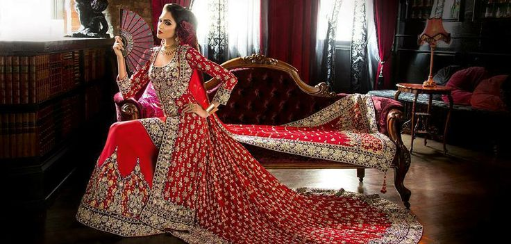 Red Pakistani Bridal Dress With A Long Tail