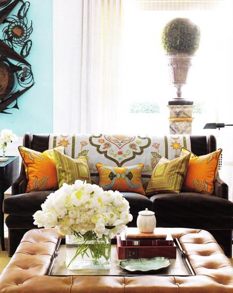 Warm, colorful living room designed by Bunny Williams | Photographed by Thomas Loof for House Beautiful