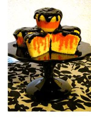 Halloween cupcakes--yellow poke cake with orange jello and chocolate icing!: