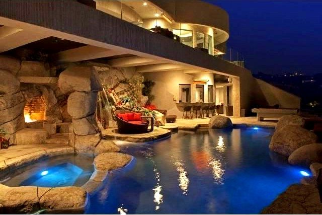 Man Cave With A Pool Hot Tub Fire Place And Outdoor Bar