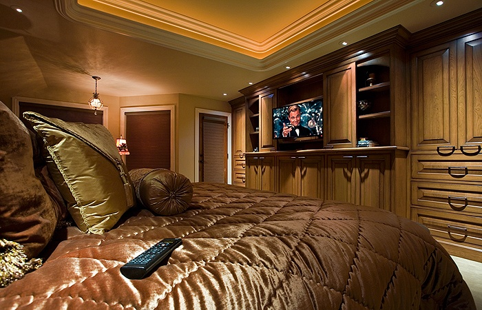 Master Bedroom With Built-in Entertainment Center In