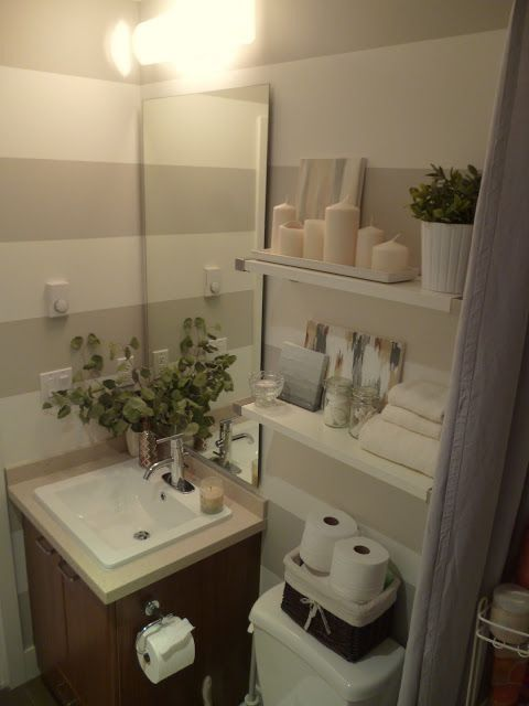 A basket is a great way to store extra toilet paper in a ... on Small Apartment Bathroom Ideas  id=49092