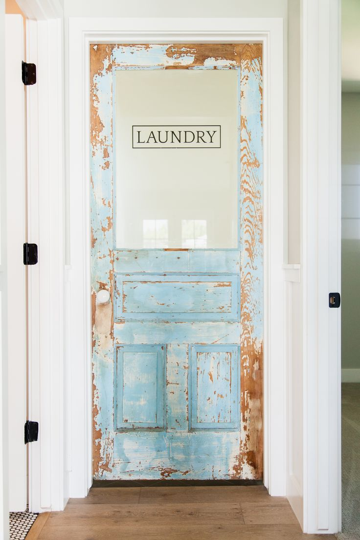Custom laundry door with original vintage paint – by Rafterhouse.