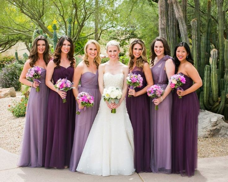 Bride And Bridesmaids In Dresses In Shades Of Purple