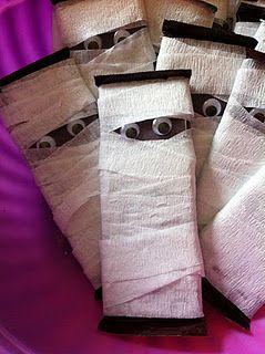 Fun Halloween favor. Use mini hershey bars, googly eyes & white crepe paper