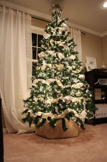 love the way she wrapped up the bottom of their tree! gonna need to remember this if I decorate next year!: