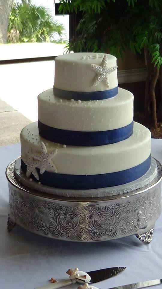 Elegant Starfish Wedding Cake With Royal Blue Ribbon 3