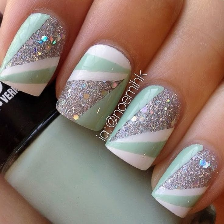 Fun and pretty go together in this glitter and strip nail art. DIY this manicure with the help of these products
