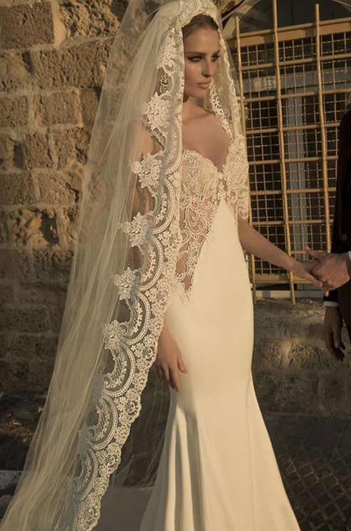 The dress is long and tight with a bottom flare and the matching lace veil is breathtaking! Galia Lahav, Spring 2015