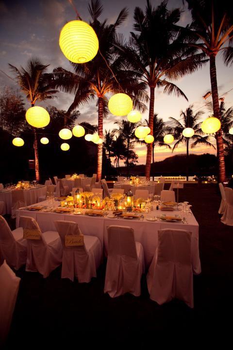 lawn wedding reception under lit laterns