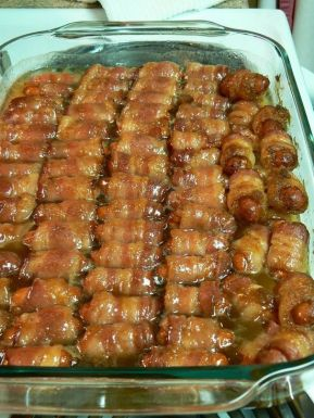 Bacon Wrapped Smokies with Brown Sugar and Butter. I guarantee if you make these, they will be gone! I made them for a gathering and everyone just kept eating them, and eating them until they are all gone. These are one of the best appetizers I've ever eaten in my life. So be sure to make plenty of these.: