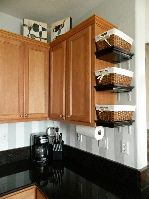 Small Shelves with baskets attached to cabinets Might do this in the new house