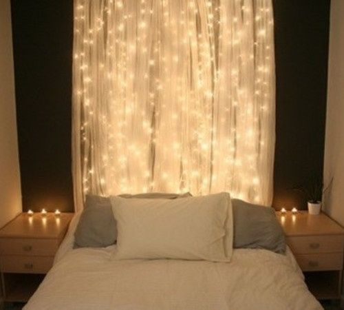 White Lights Behind A Sheer Curtain Behind The Bed Home