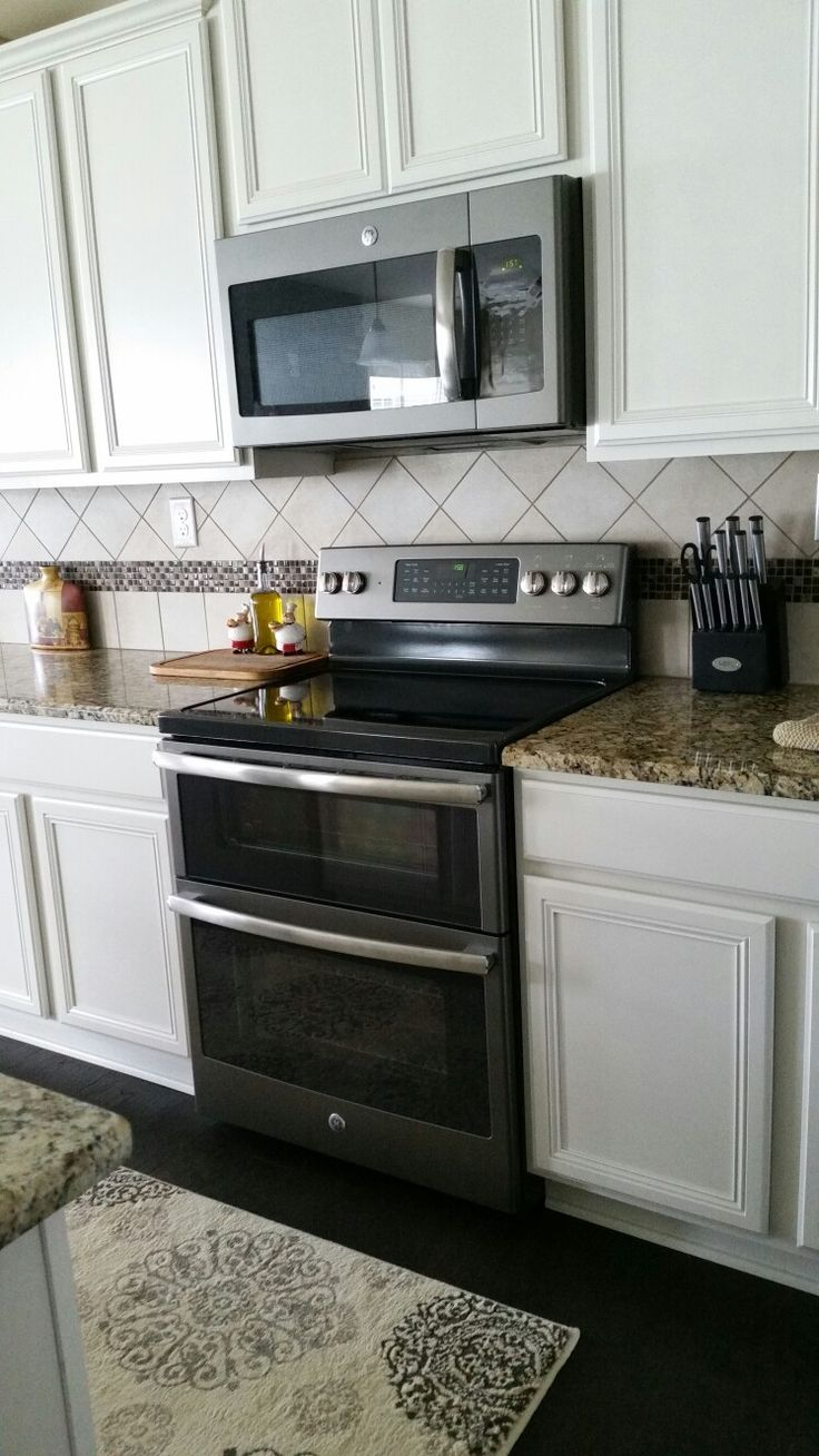 ge slate appliances with antique white cabinets our house pinterest antique white on kitchen appliances id=57977