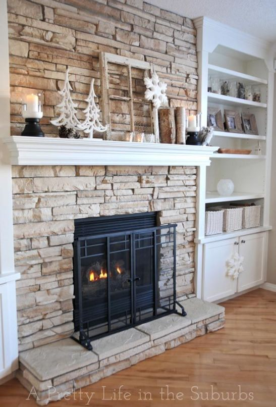 Stone for fireplace. Then I'm thinking floating shelves on both sides if fire place. A place for the TV and two storage cabinets are both sides for balance.: