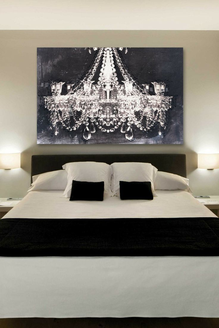 The chandelier art by Oliver Gal gives a romantic touch to this bedroom.