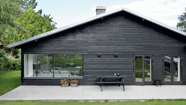 A black wooden house outside but …