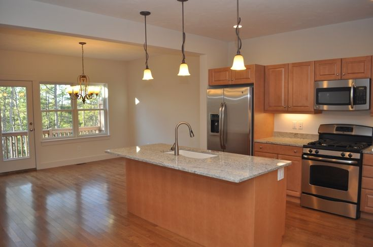 maple cabinets, Bianco Romano granite counters, stainless ... on Maple Cabinets With White Countertops  id=82413