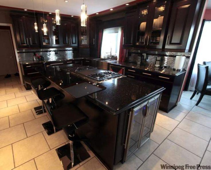 Kitchen: 'Black Galaxy' granite countertop with espresso ... on Maple Kitchen Cabinets With Black Granite Countertops  id=36562