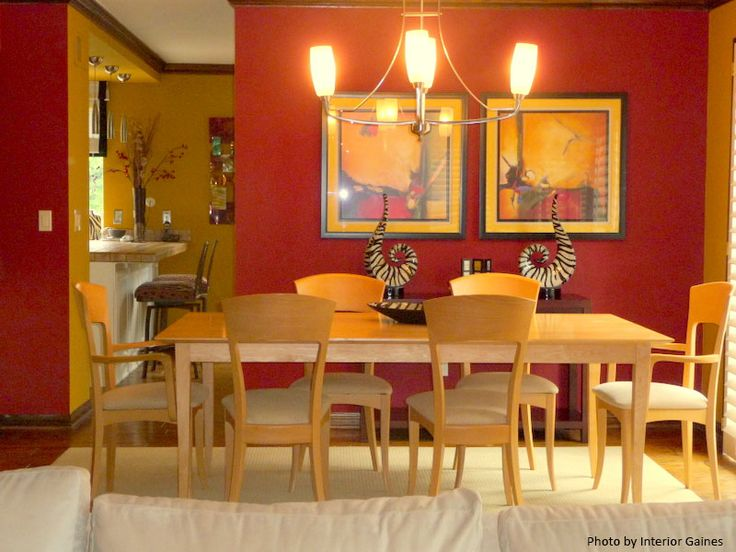 A Beautiful Modern Dining Room With Red Accent Wall. Light
