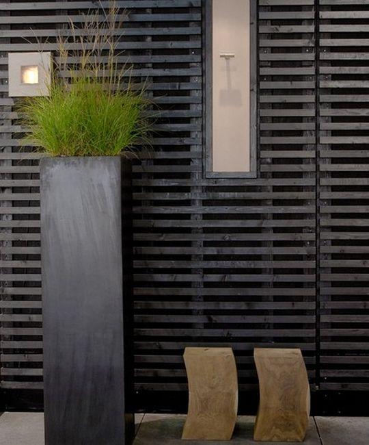 Horizontal Black Timber Batten Screen Pinned To Garden