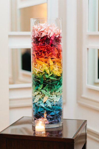 Opt for paper cranes instead of flowers as your centerpieces for a colorful and fun touch to your wedding: