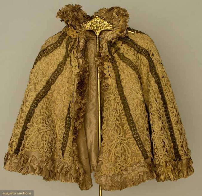 """Augusta Auctions, April 17, 2013 - NYC, Lot 209: """"Battenburg Lace Capelet"""", 1890s  Tape lace capelet, high stand collar, gold bullion trim, silk lining (damaged) very good.:"""