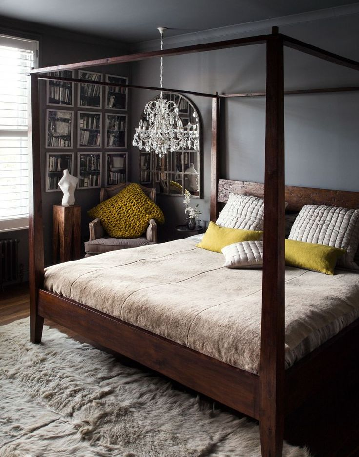 Dark Atmospheric Bedroom With Four Poster Bed And Low