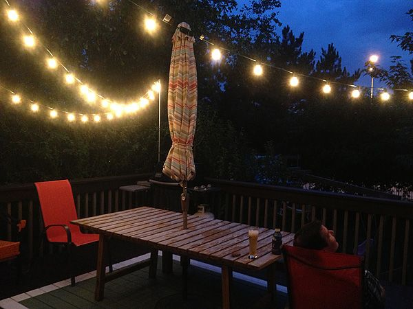 how to hang string lights over a deck out back on awesome deck patio outdoor lighting ideas that lighten up your space id=91562