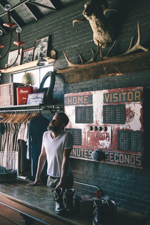 rustic shop interior brick wall black log cabin on walls coveralls website id=41815