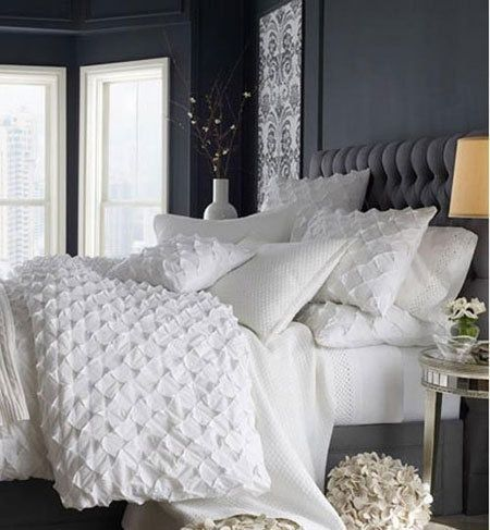 White comforters are the most inviting. All you want to do is jump into that clo