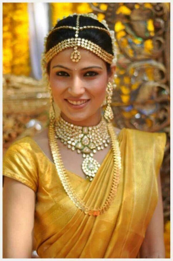 South indian bride in yellow silk saree Hindu Wedding
