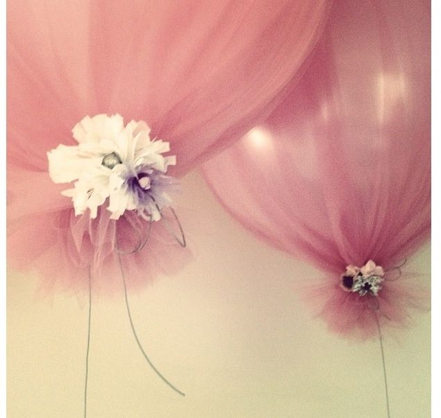 Tulle wrapped over balloons.