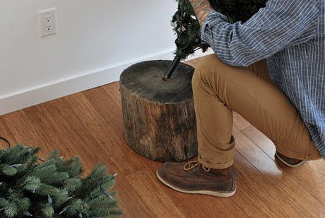 Tree Stump Stand for Artificial Tree…This looks so much nicer then the traditional tree skirts around tree stands. It probably