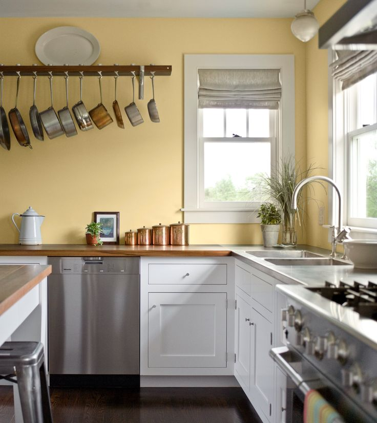 pale yellow walls white cabinets wood counter tops on what is a wall id=41634