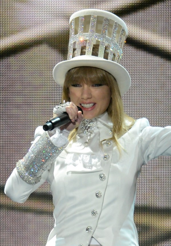 Taylor Swift performs in Louise Green Top Hat at the 55th ...