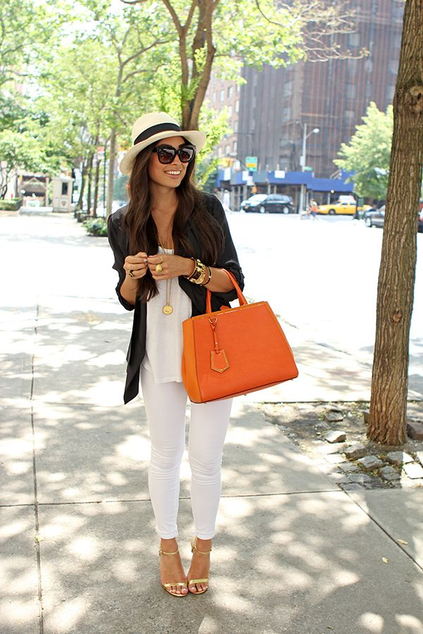 White skinny jeans, white top, dark blazer, gold accessories and a pop of color with the handbag.
