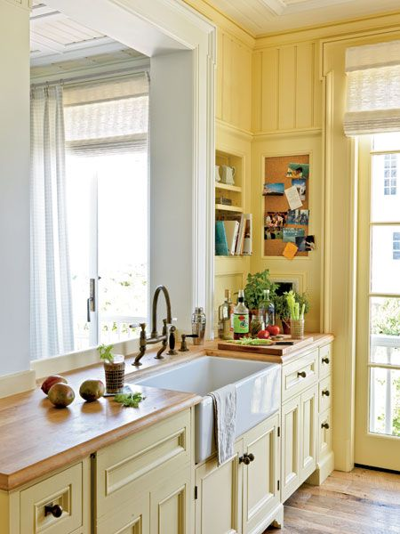 Butcher-block countertops add beach-cottage charm at a good price in this kitchen in Seaside, Florida. Buttery walls and cabinets