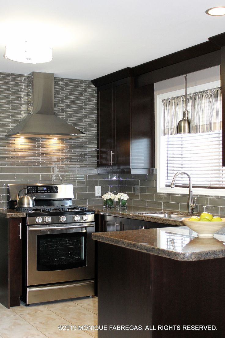 Delicious chocolate-stained maple cabinets topped with ... on Backsplash For Maple Cabinets And Black Granite  id=36282